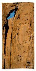 Beach Towel featuring the photograph Portal Through Stone by Jeff Kolker