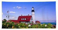 Portland Head Light And Roses Beach Towel by Mitchell R Grosky