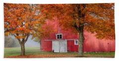Red Barn With White Barn Door Beach Towel by Jeff Folger