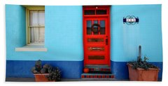 Red Door On Blue Wall Beach Towel