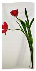 Red Flowers In Glass Vase Beach Sheet