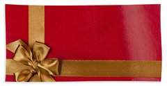 Red Gift Background With Gold Ribbon Beach Towel