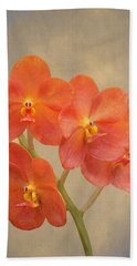 Red Scarlet Orchid On Grunge Beach Towel