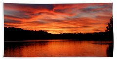Red Sunset Reflections Beach Towel by Denyse Duhaime