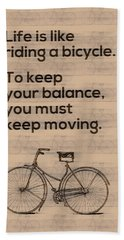 Riding A Bicycle And Keep Moving Beach Towel