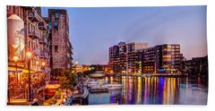 Riverwalk At Dusk Beach Towel