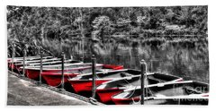 Row Of Red Rowing Boats Beach Towel