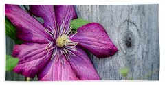 Beach Towel featuring the photograph Rustic Clematis by Susan  McMenamin