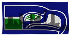 Seattle Seahawks On Seattle Skyline Beach Towel