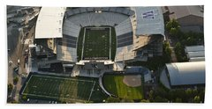 Seattle With Aerial View Of The Newly Renovated Husky Stadium Beach Towel