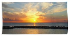 Seven Mile Sunset Over Grand Cayman Beach Towel by Amy McDaniel
