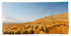 Shepherd Standing With Flock Of Sheep Beach Towel