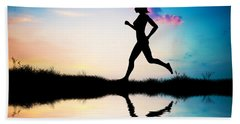 Silhouette Of Woman Running At Sunset Beach Towel by Michal Bednarek