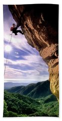 Silhouetted Climber Rapelling Beach Towel