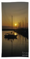 Silhouetted Man On Sailboat Beach Sheet