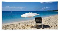 Single Beach Chair And Umbrella On Beach Towel