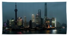Skylines At The Waterfront At Night Beach Towel