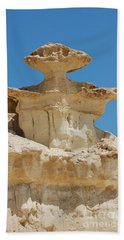 Smiling Stone Man Beach Towel by Linda Prewer