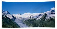 Snow Covered Mountain Range With A Beach Towel