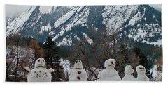 Flatiron Snowmen. Beach Towel