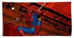 Spiderman Swinging Through The Air Beach Sheet by John Telfer