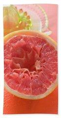Squeezed Pink Grapefruit In Front Of Citrus Squeezer Beach Towel