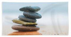 Stack Of Beach Stones On Sand Beach Towel