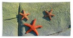 Starfish On The Rocks Beach Towel