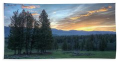 Sunrise Behind Pine Trees In Yellowstone Beach Sheet