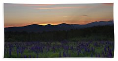 Sunrise Over A Field Of Lupines Beach Towel
