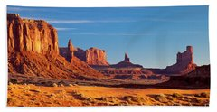 Beach Towel featuring the photograph Sunrise Over Monument Valley by Brian Jannsen