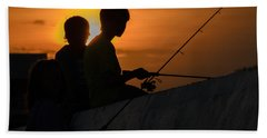 Sunset Anglers Beach Towel by Keith Armstrong