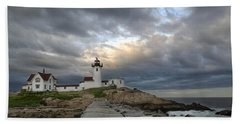Sunset At Eastern Point Lighthouse Beach Towel
