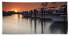 Sunset At The Pelican Yacht Club Beach Towel