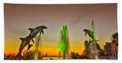 Sunset Dolphins Beach Towel