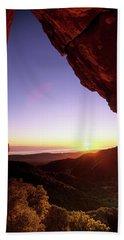 Sunset Landscape Framed  By Rock Faces Beach Towel