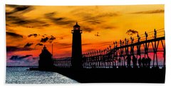 Sunset Walking On Grand Haven Pier Beach Towel by Nick Zelinsky