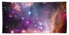 Beach Towel featuring the  Taken Under The Wing Of The Small Magellanic Cloud by Paul Fearn