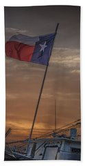 Texas Flag Flying From A Fishing Boat At Sunrise Beach Towel
