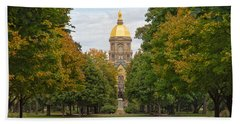 The Golden Dome Of Notre Dame Beach Towel by John M Bailey