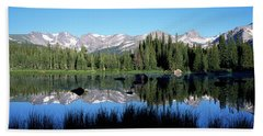 The Indian Peaks Reflected In Red Rock Beach Towel