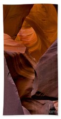 Beach Towel featuring the photograph Three Faces In Sandstone by Mae Wertz
