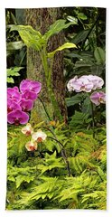Three Orchid And A Tree Beach Towel