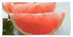 Three Pink Grapefruit Wedges, Leaves Beside Them Beach Towel