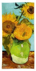 Three Sunflowers In A Vase Beach Towel