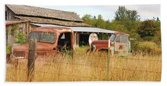 Beach Towel featuring the photograph To Everything There Is A Season. Rusty Old Trucks And A Barn by Connie Fox