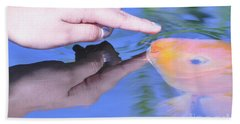Touching The Koi.  Beach Sheet by Debby Pueschel