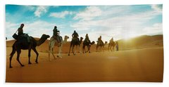 Tourists Riding Camels Beach Towel