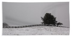 Tree And Fence In Snow Storm Beach Towel