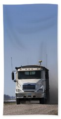Truck Driving On Dusty Gravel Road Beach Towel